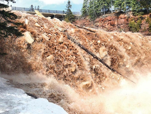 Bob King of the Duluth News-Tribune timed it perfectly — he arrived at Gooseberry Falls just before ice-out and took an incredible video and photos. For the link, see below.