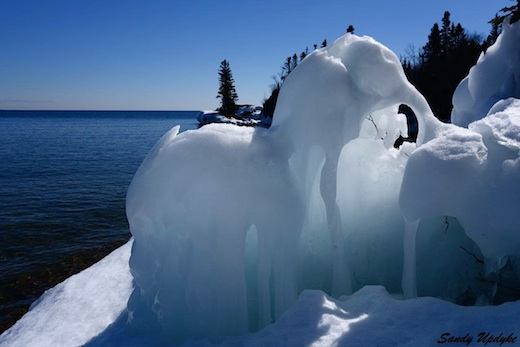 Two ice elephants having a chat, by Sandra Updyke.