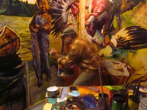 David Gilsvik works on one of the murals for the Grand Portage National Monument Heritage Center.