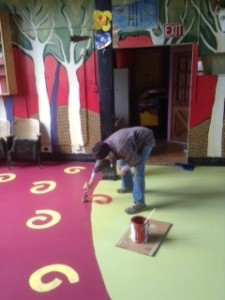 Betsy Bowen is just about finished painting the floor in the redesigned What's Upstairs? Stage above her studio at 301 1st Ave. W.