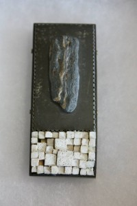 """Singular,"" by Tova Lund. Brooch with copper, tin, slate, & wood."