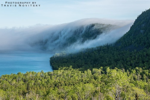 Fog over Hat Point and Mt. Josephine by Travis Novitsky.