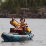 Yvonne Caruthers played her cello from a kayak in the East Bay. recently.
