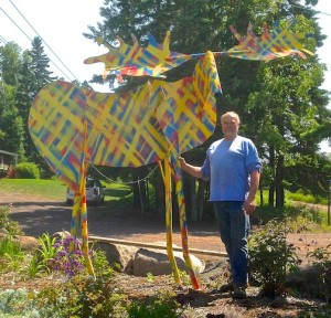 Tom Christiansen stands behind his moose sculpture at Last Chance Gallery in Lutsen.