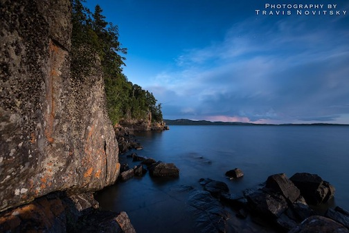 """The Blue Moon shines on Wauswaugoning Bay"" by Travis Novitsky."
