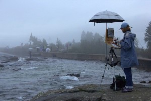 A plein air painter captures a moment during the Quick Paint competition on Artist's Point last week