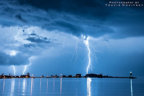 Thunder storm over Grand Marais by Travis Novitsky.