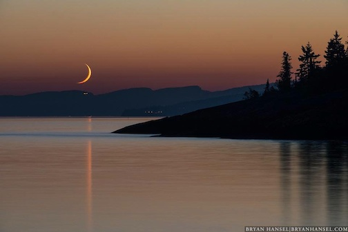 """""""Crescent Moon above the Lutsen Chalet on Moose Mountain"""" by Bryan Hansel."""