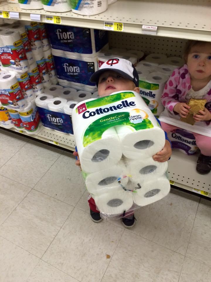 Ari helps his mom, Molly Hicken, go shopping.