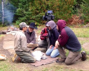 Erik Simula teaches a Discovery Channel crew about wild rice harvesting and processing.