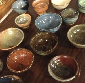 A wide variety of colorful bowls have been made for Empty Bowls.