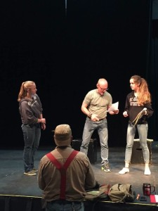 "Mark Abrahamson reads from a script during a rehearsal of ""As You Like It"" as Director Marco Good watches. Shae Morowitz and Santina McMillan are also in the scene. The play opens Nov. 12."