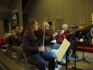 Members of the Borealis Orchestra rehearse one of the pieces for the Christmas concert. (File photo)