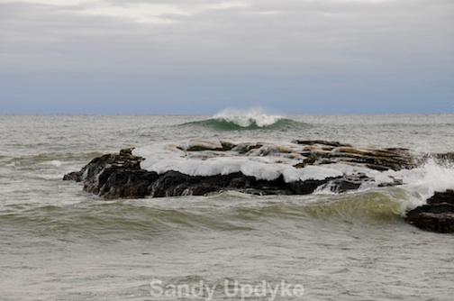 Waves rolling in by Sandra Updyke.