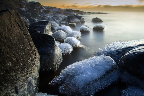 Icy Rocks on shore by Jamie Rabold.