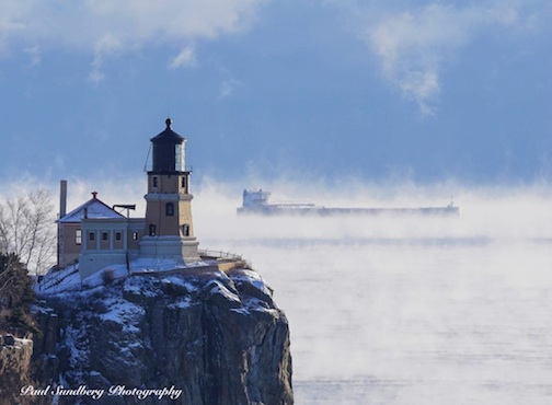Yesterday, right before sunset, North Shore photographer Paul Sundberg was driving by Split Rock and got this great photograph of the American Integrity sailing by the lighthouse in the sea smoke. The temperature was one below at the time