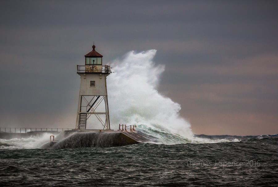 Thomas Spence caught this huge wave crashing over the breakwater the other day.