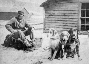 Historic photo of John Beargrease, the toboggan he loaded with mail  and his sled dogs that pulled it up the North Shore.