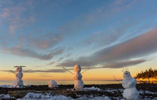 """SnowmanFamily Enjoying a Grand Marais Sunrise,"" by David Johnson."