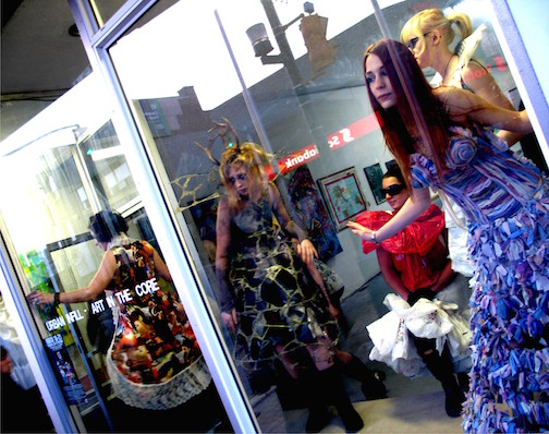 Wearable Art performances are held in the windows of downtown shops on Saturday night.