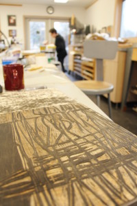 Beth Dorsey, seen here working in the Art Colony's print studio this week, will teach a workshop on Saturday.