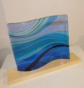"This fused glass piece by Nancy Seaton is in the ""Sense of Wonder"" exhibit."