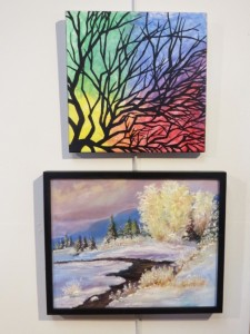 "Two of the paintings on exhibit in the show: ""Hued Sapling"" by Sarah Smith and ""Frosty Moon on Sawbill by Kathelen Fox Weiberg."