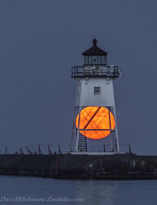 """Moon Got Stuck for Awhile in the Lighthouse Frame"" by David Johnson."