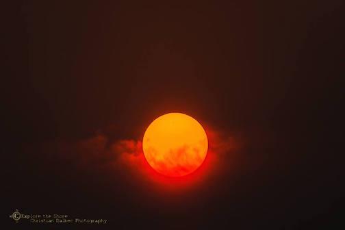 Smokey Sunset by Christian Dalbec.