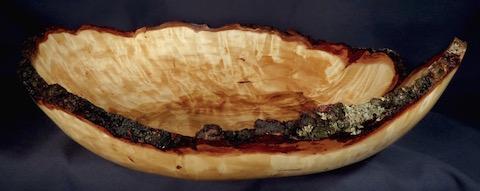 A 18-inch diameter burl bowl by Lou Pignolet.
