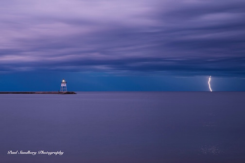 Storm Over Grand Marais by Paul Sundberg.
