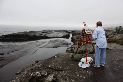 An artist participates in the Quick Paint, 2015.