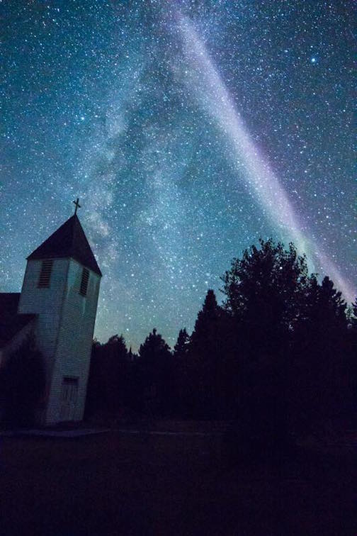 """Spirit of the Wilderness Church with a proton arc"" by David Coleman."