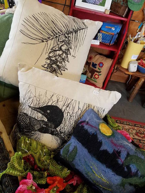 Pillows in a variety of designs and shapes by local artists can be found at Joy & Co.