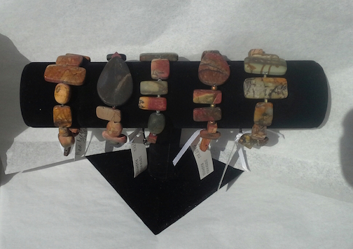 Red Creek jasper bracelets by Judy Hurd are featured at Last Chance Gallery