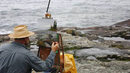 A Plein Air artist paints Artist Point during the Quick Paint competition.