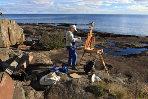 A plein air painter on Artist Point during the Quick Paint Competition a few years ago.