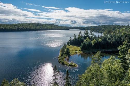 Moss Lake in late summer by Travis Novitsky.
