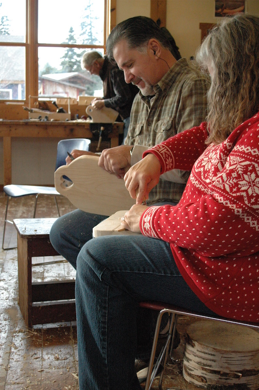 Students carve cutting boards at a North House workshop.