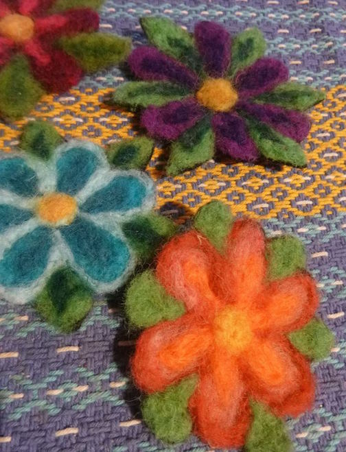 Bonnie Gay Hedstrom has felted pins at the Holiday Art Underground Show at Betsy Bowen's Studio & Galleries.