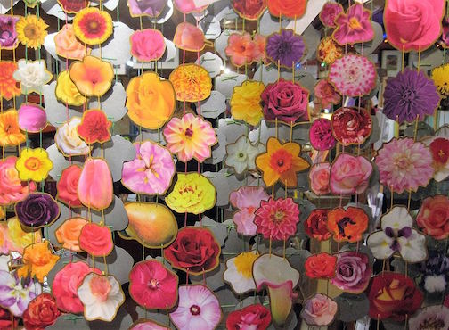 Marce Wood's colorful flower garlands are featured at the Holiday Art Undergroun.