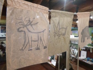 Kelly Dupre made a series of handprinted flags for the Holiday Underground show.
