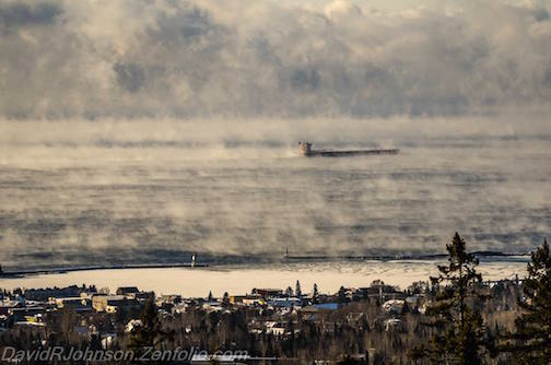 The Coolest Small Town in America enjoying subzero sea smoke as a laker passes by, brrr by David Johnson.