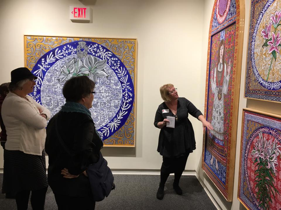 Alison Aune points out a detail in her work at the opening of 4North at the Duluth Art Institute.