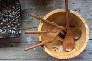Kah Nee Tah Gallery has wooden bowls by Wayne Johnson and spoons by Jonathan Simons. A platter by potter Maggie Anderson is also pictured. Photo  by Oullis Photography.