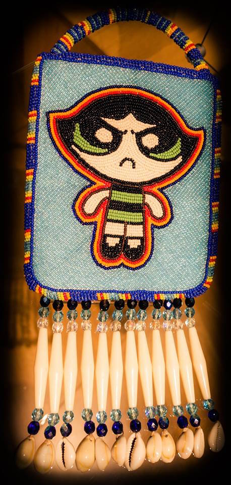 """Powederpuff Girl: Buttercup,"" Beaded deerskin bag with beaded handle and fringe with glass, antler and cowrie shells by Barbara R. Lacapa/Asabikeshi-ikwe or Spider Woman."
