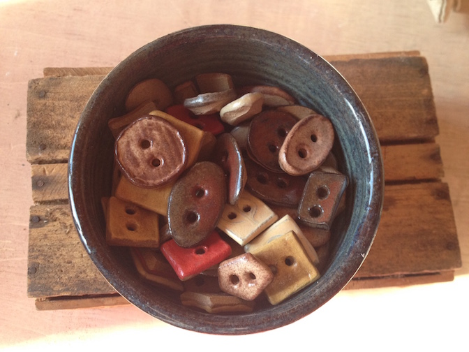 Melissa Wickwire has a wide variety of handmade buttons at North House Folk School. To find out more about her work, visit www.wickwireclayworks.com.