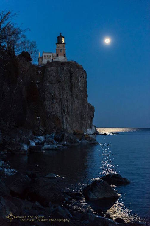 Moon Over Split Rock Lighthouse by Christian Dalbec.