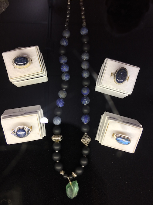 Here are a few examples of his work-- a necklace crafted from lapis lazuli, onyx and fluorite.  The rings are made from kyanite, opal and lapis.
