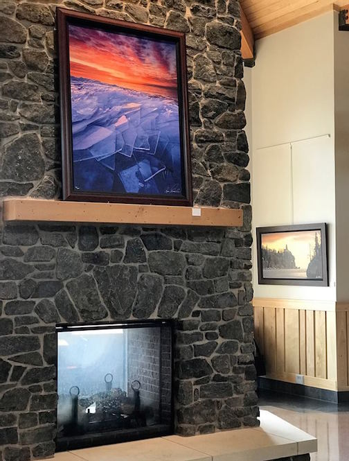 A Ryan Tischer painting above the fireplace at Tettegouche State Park.
